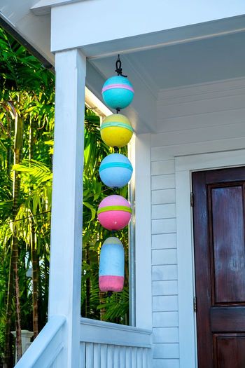 Multi colored lanterns hanging on door of building