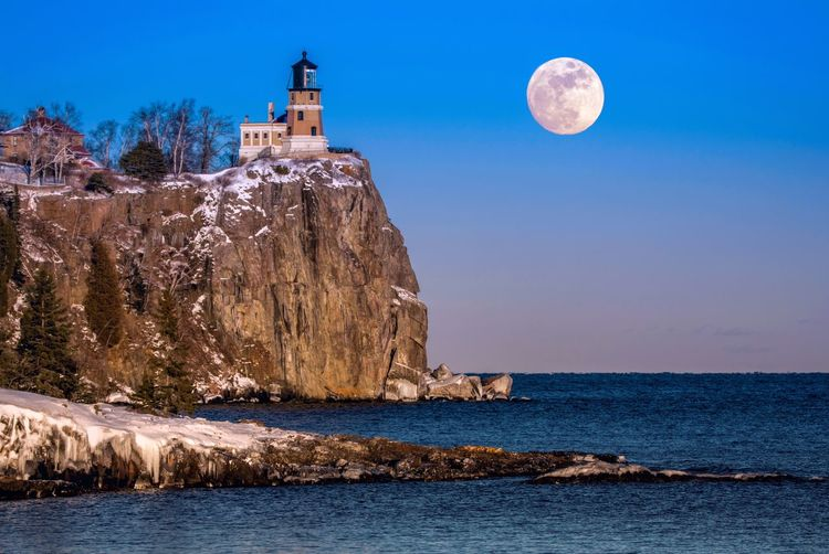 Winter moon over Split Rock Lighthouse Streamzoofamily Architecture Scenics Sky Beauty In Nature Building Exterior Nature Built Structure Rock - Object Moon Outdoors Water Tranquility Real People Day Astronomy Malephotographerofthemonth Beauty In Nature Minnesota Lake Superior Moon Winter Tranquil Scene Landscape Lakesuperior
