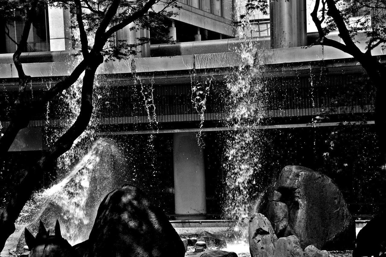 motion, long exposure, water, fountain, blurred motion, splashing, real people, outdoors, tree, spraying, lifestyles, men, day, nature, one person, people
