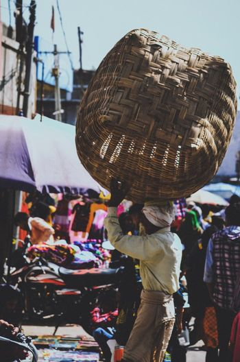 Vendor carrying basket in market