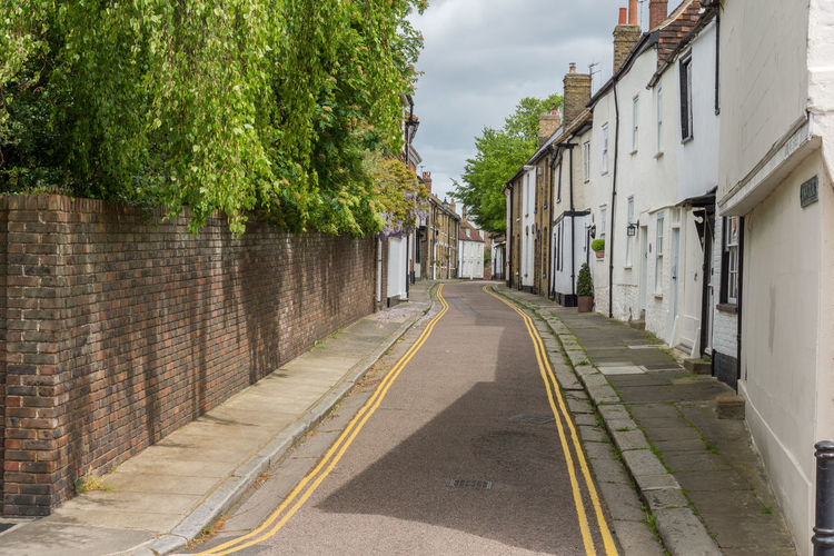 Alley Architecture Building Building Exterior Built Structure Day Diminishing Perspective House Long Narrow Outdoors Residential Building Residential Structure Sky Street The Way Forward Tree Vanishing Point Walkway