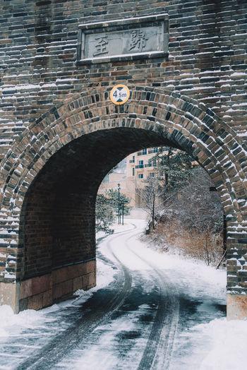 Arch bridge over road in city