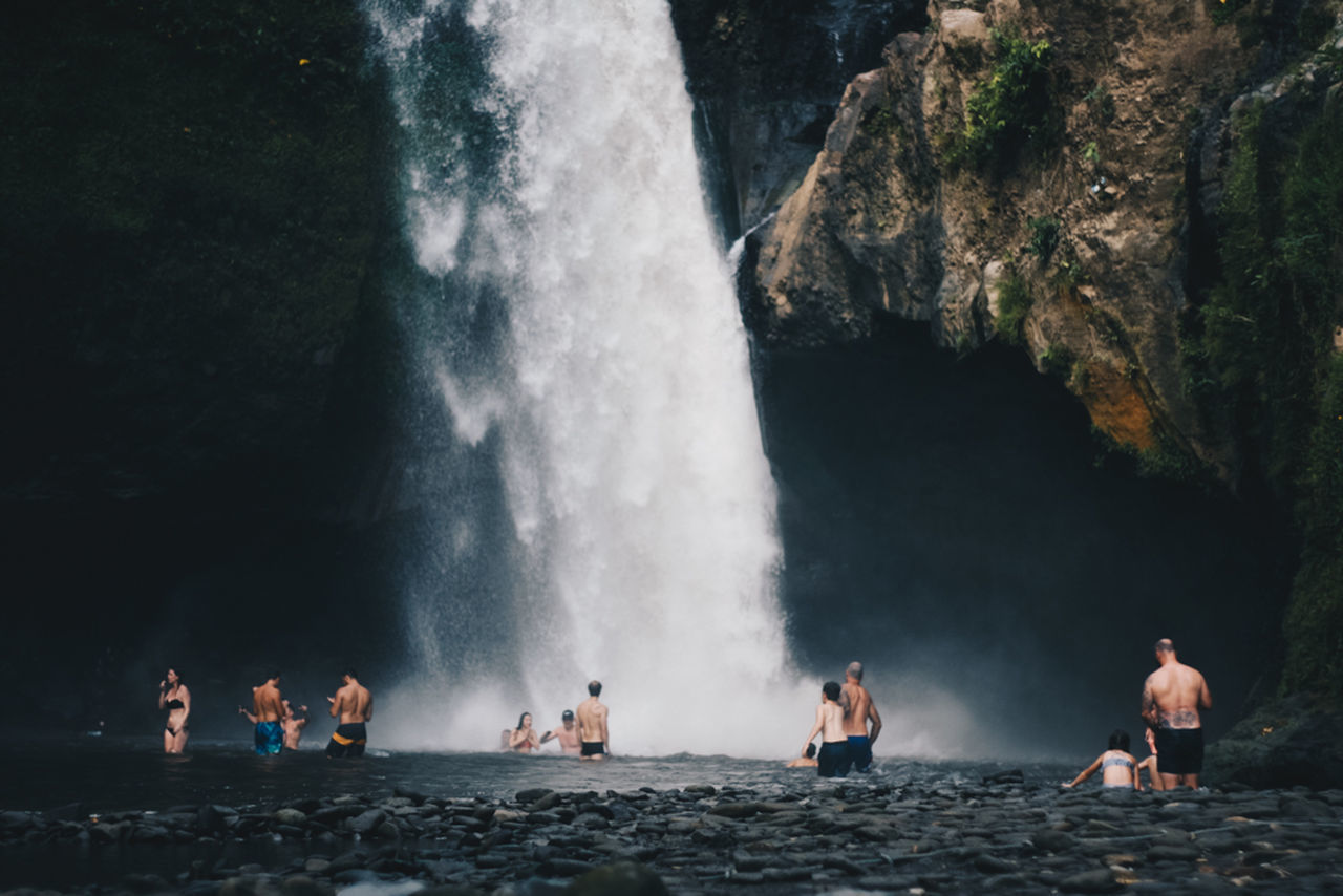 group of people, real people, water, waterfall, long exposure, motion, women, leisure activity, lifestyles, scenics - nature, rock - object, adult, men, nature, rock, beauty in nature, people, solid, day, flowing water, power in nature, outdoors