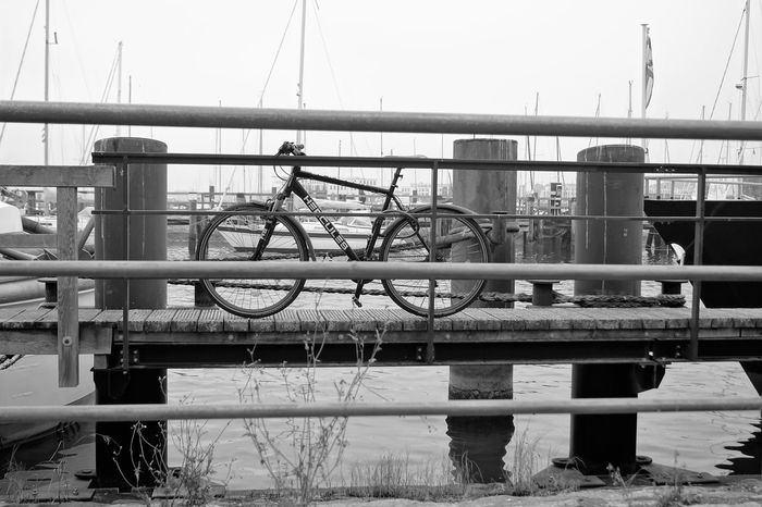 Harbor Monochrome Photography Bicycle Focus On Foreground Outdoors Connection Day Railing Water No People Bridge - Man Made Structure Transportation Blackandwhite Tranquility Travelling Landing Stage Sailboat Water Reflections
