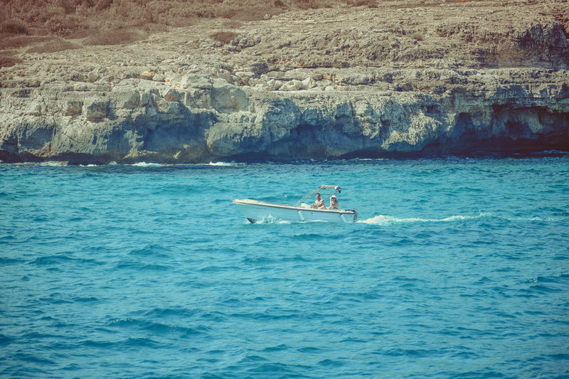 Water Nature Beauty In Nature Sea Waterfront Day Outdoors Scenics - Nature Mediterranean  Blue Sky Transportation Nautical Vessel Real People People Sailing Two People Motion Travel Leisure Activity