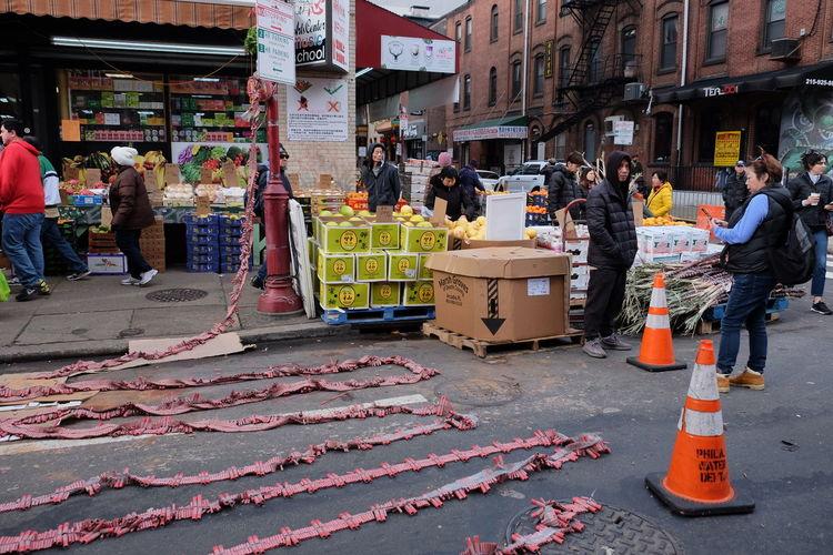 People on street market in city
