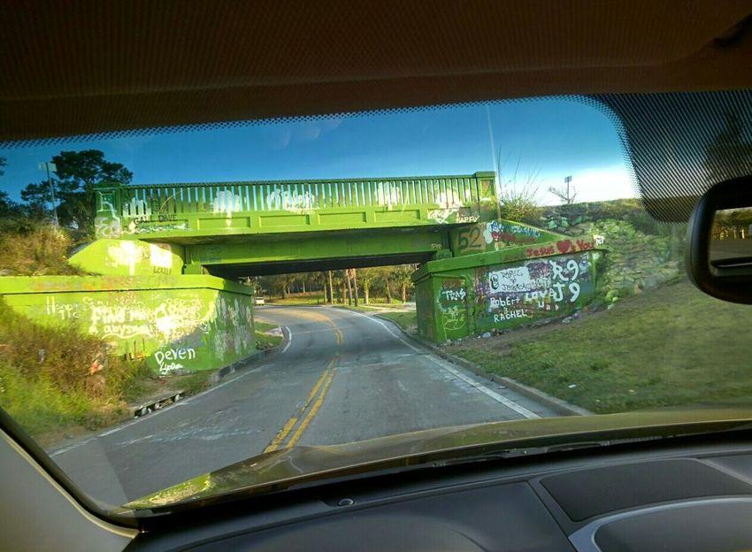 Pensacola 17th Street Bridge Open Edit Taking Photos Graffiti Art St Patrick's Day Luck Of The Irish Through Glass Bridge Graffiti Through My Windshield Green Green Green!