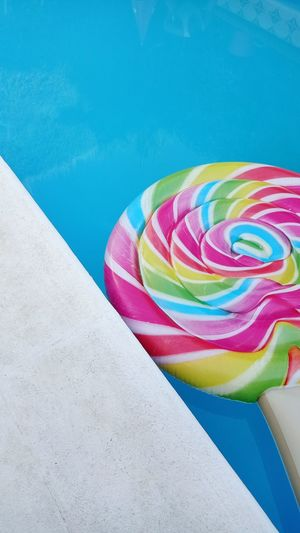 High angle view of multi colored umbrellas on swimming pool