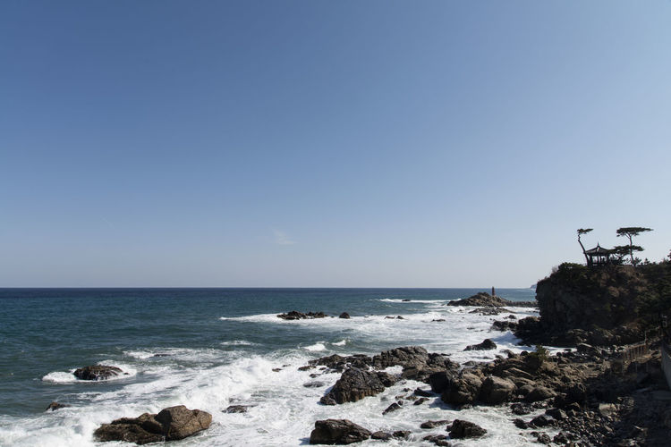 Sea view from Naksansa, Yangyang, Gangwondo, South Korea Beach Beauty In Nature Blue Clear Sky Day Horizon Over Water Naksansa Nature No People Outdoors Rock - Object Scenics Sea Seaside Sky Travel Destinations Water Wave