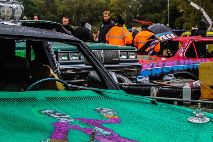 Banger Racing Cars Car Men Group Of People Real People Transportation Women Mode Of Transportation People Crowd Adult Day Leisure Activity Arts Culture And Entertainment Occupation Water Lifestyles Outdoors Nautical Vessel Enjoyment Swimming Pool Inflatable