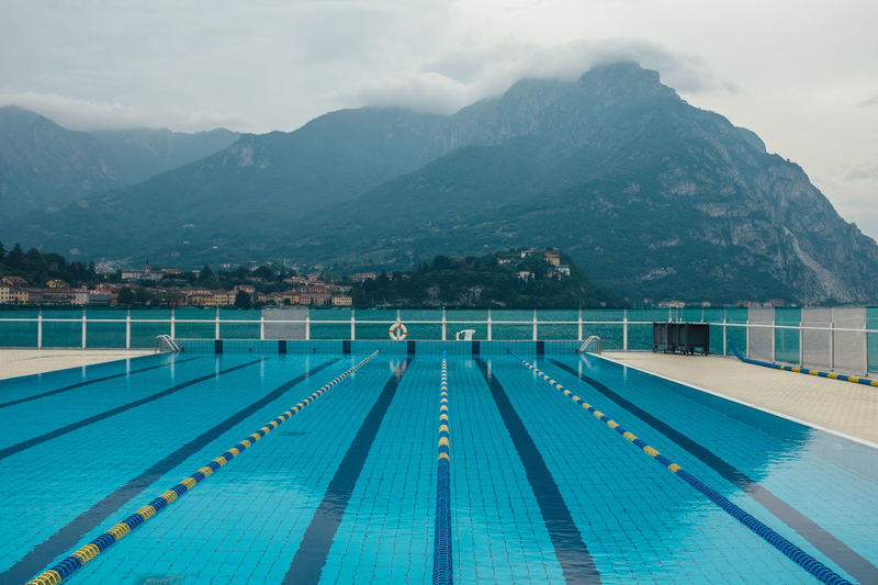 Como Lake Blue Built Structure Cloud - Sky Direction Italian Italy Lecco Mountain Mountain Range Nature No People Outdoors Pool Scenics - Nature Sky Swimming Lane Marker Swimming Pool The Way Forward Turquoise Colored Water The Traveler - 2018 EyeEm Awards The Great Outdoors - 2018 EyeEm Awards EyeEmNewHere A New Beginning A New Perspective On Life