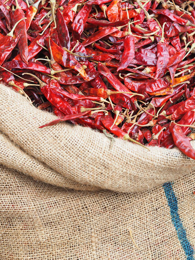 High Angle View Of Dried Red Chili Pepper In Sack At Market