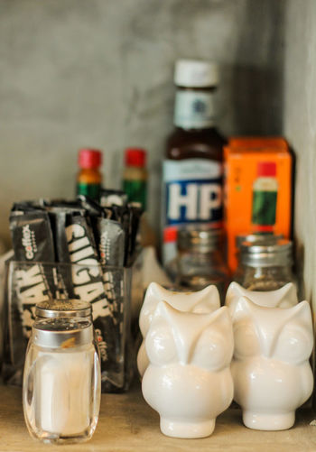 Close-up of bottles in jar on table