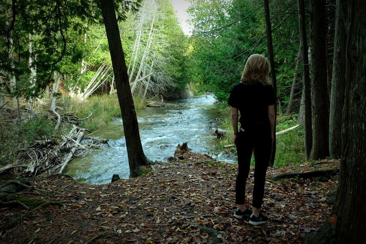 nature at its best Candid Rear View Water One Person Tree Real People Nature Day Women Outdoors Forest Full Length Tree Trunk Standing Beauty In Nature Adult One Woman Only Only Women People Adults Only