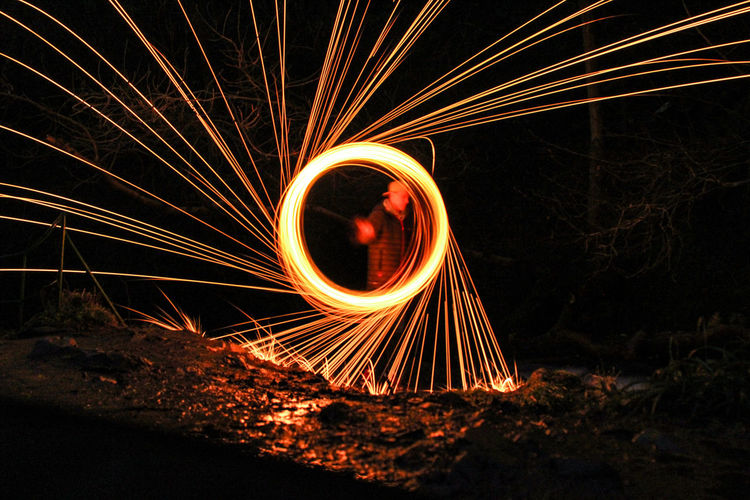 Night Long Exposure Wire Wool Light Painting Motion Circle Illuminated Danger Outdoors Arts Culture And Entertainment Light Trail No People Fireball