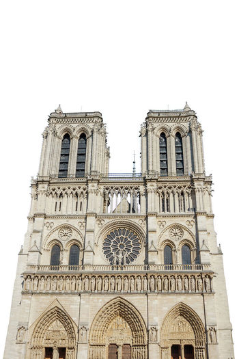 Notre Dame de Paris central main facade, national monument cathedral of France. French Gothic architecture. isolated on white background and copy space. Notre Dame De Paris Notre Dame De Paris Exterior Paris Church Cathedral France Isolated Isolated White Background Isolated On White Building Exterior Architecture Built Structure Sky Low Angle View Clear Sky Building Travel Destinations No People Arch The Past History Religion Belief Nature Place Of Worship Copy Space Day Spirituality Outdoors Gothic Style Ornate