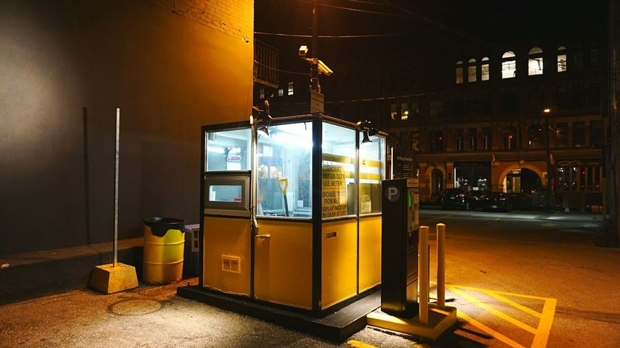 Cabin by parking meter at night