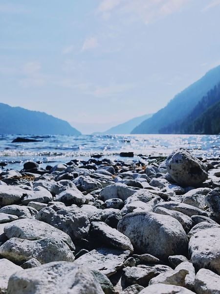 Nature Beauty In Nature No People Outdoors Tranquil Scene Tranquility Scenics Pebble Pebble Beach Sea Sky Day Water Beach Rock - Object Mountain Rocks Shore Lake View