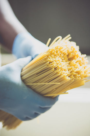 Cropped image of person making spaghetti