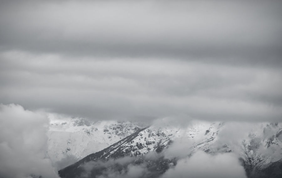 cloudy and snowy Above Beauty In Nature Cloud - Sky Cloudscape Day Dramatic Sky Environment Fog Landscape Mountain Mountain Peak Mountain Range Nature No People Ominous Outdoors Scenics - Nature Sky Snow Softness Storm Tranquil Scene Tranquility