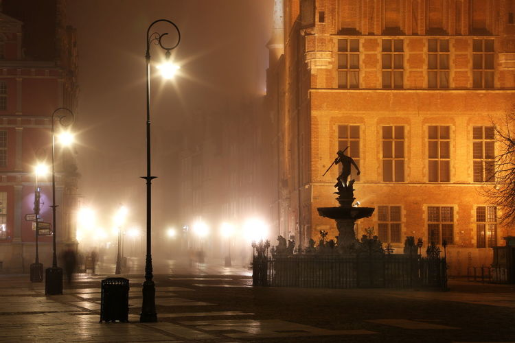 Statue In City At Night