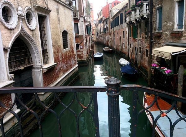 Water Travel Destinations Canal Building Exterior Architecture Reflection Built Structure Outdoors No People Gondola - Traditional Boat Day Venice Old Town Old Buildings Tranquility Beauty In Nature Italy Relaxation Landscape Scenics Vacations Cityscape City Travel Illuminated