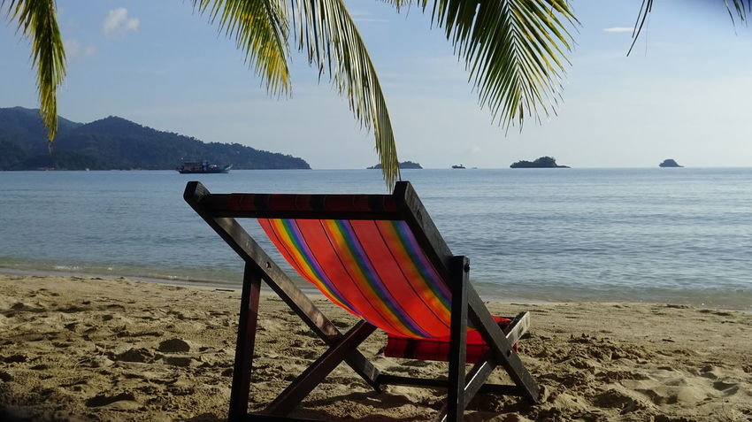 Relax at the beach in KoH Chang Deck Chair Meer Strand Streifen Beach Beauty In Nature Chair Colorful Day Eyemtravel Horizon Over Water Liegestuhl Nature No People Outdoors Palm Tree Sand Scenics Sea Sky Tranquil Scene Tranquility Tree Water