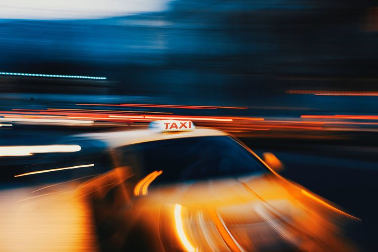 Blurred motion of taxi at night