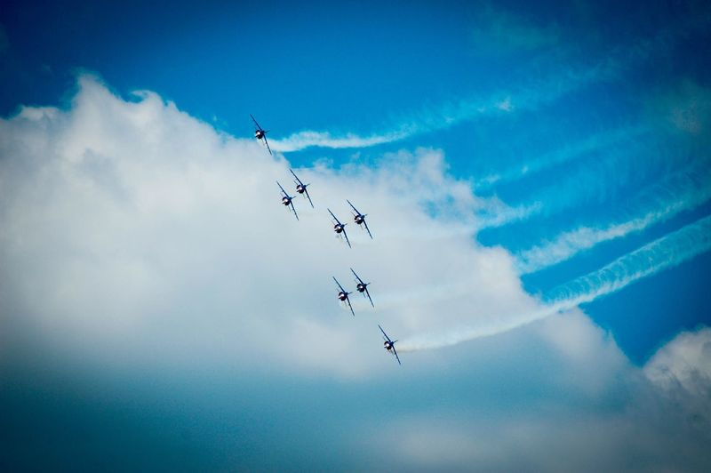 Flying Airshow Low Angle View Teamwork Mid-air Sky Speed Cloud - Sky Fighter Plane Vapor Trail Motion Air Vehicle Blue Formation Flying Airplane Military Airplane Day Outdoors Coordination