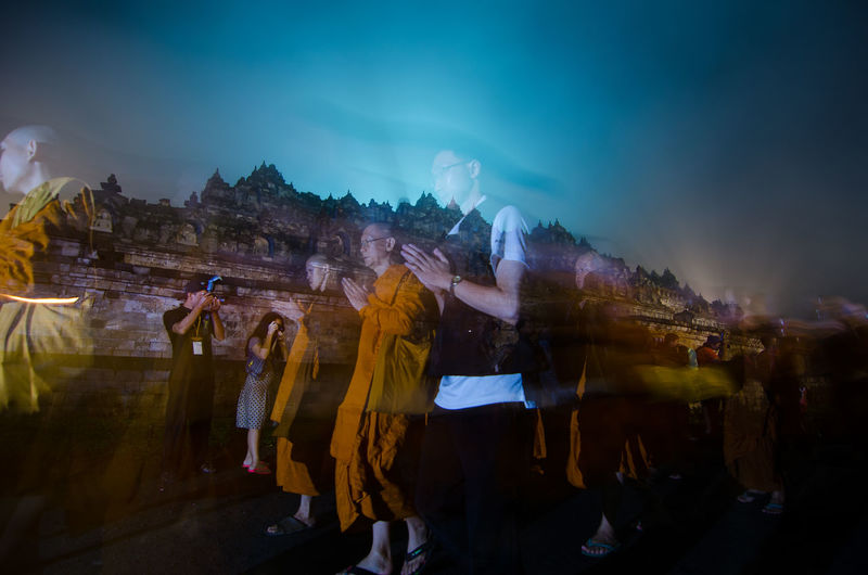 15 may 2014, Magelang, Indonesia : Participants releasing lanterns over the Borobudur temple in Magelang, Central Java during Vesak/Waisak Day celebrations Adult Architecture Building Exterior Built Structure City Crowd Dancing Group Of People Leisure Activity Lifestyles Men Motion Nature Night Outdoors People Real People Sky Women