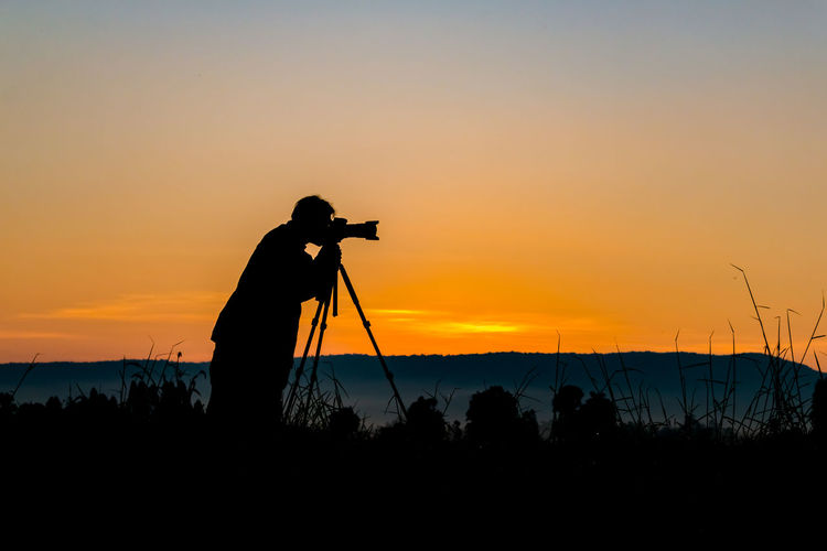 Silhouette Of Photographer Against Sky During Sunset