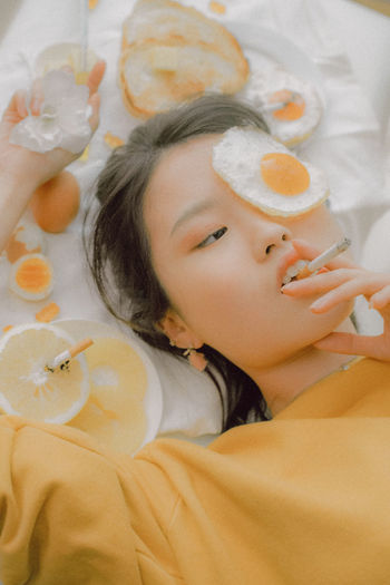 The Creative - 2018 EyeEm Awards The Portraitist - 2018 EyeEm Awards The Still Life Photographer - 2018 EyeEm Awards Bed Child Childhood Females Food Food And Drink Furniture Headshot High Angle View Indoors  Innocence Lifestyles Lying Down One Person Portrait Real People Relaxation Women