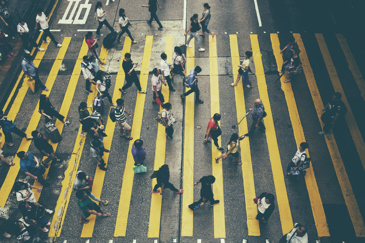 High angle view of people walking on zebra crossing