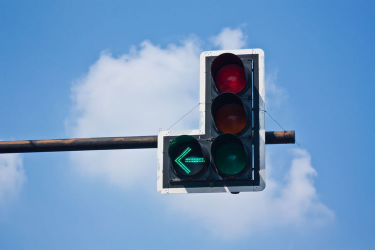 Traffic lights Cloud - Sky Communication Day Green Light Guidance Illuminated Light Lighting Equipment Low Angle View Nature No People Outdoors Red Light Road Road Sign Road Signal Rules Safety Sign Sky Stoplight