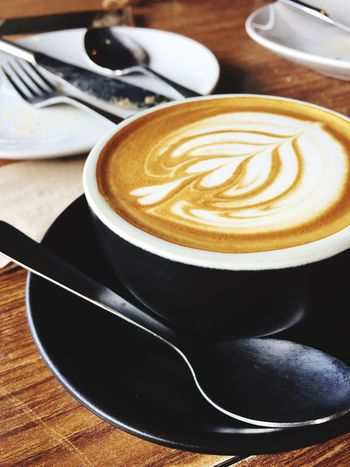 Coffee - Drink Coffee Cup Cappuccino Table Drink Frothy Drink Froth Art Refreshment Food And Drink Saucer Indoors  High Angle View Latte No People Close-up Day Freshness