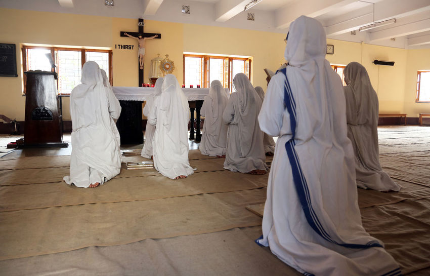 Sisters of Mother Teresa's Missionaries of Charity in prayer in the chapel of the Mother House, Kolkata, India at February 08, 2014. Missionaries Agnes ASIA Bojaxhiu Calcutta Catholic Charity Christianity Faith Gonxhe Humanitarian India Kolkata Mission Mother Mother House Nun Poor  Prayer Prize Religious  Sister Teresa West Bengal