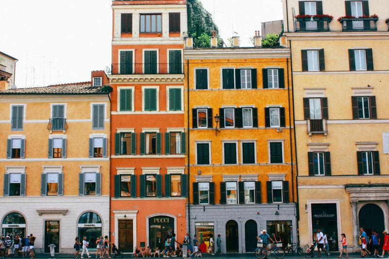 People walking by residential buildings