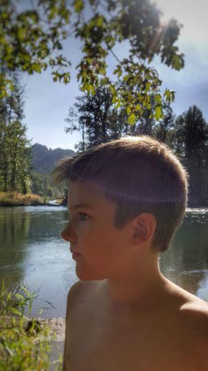 Portrait of boy looking away in lake