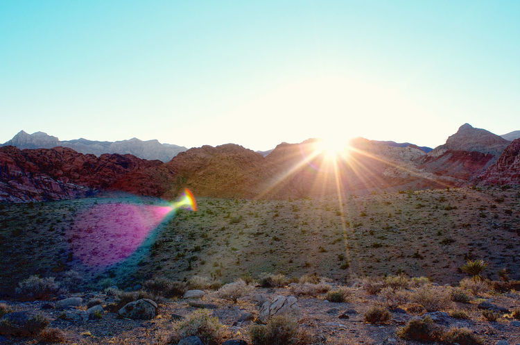 Red Rock Canyon, Nevada Beauty In Nature Clear Sky Geology Glowing Heat - Temperature Lens Flare Mountain Mountain Range Multi Colored Nature No People Non-urban Scene Outdoors Physical Geography Scenics Stone - Object Sun Sunbeam Tourism Tranquil Scene Tranquility