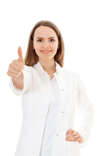 on white background Brunette Career Doctor  Gesture Hand Sign Med School Med Student Medical Personnel Medical Staff Medical Student Physician Studio Shot Thumbs Up White Background Young Adult