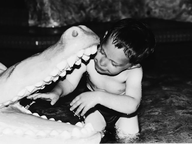Animal Themes Babyhood Black And White Photography Care Childhood Childhood Memories Close-up Human Hand Krokodile Leisure Activity Real People Togetherness