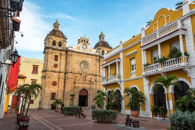 Beautiful view of historic church and colonial architecture in Cartagena, Colombia American Architectural Architecture Beautiful Bolivar Building Cartagena Cartagenadeindias Castle Cathedral Church City Colombia Colonial Downtown Façade Landmark Sanpedro Southamerica Spanish Street Town Tropical Unesco Urban