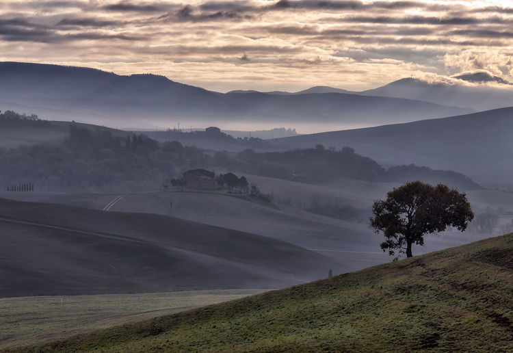 Scenic View Val D'orcia Landscape Against Sky During Sunset