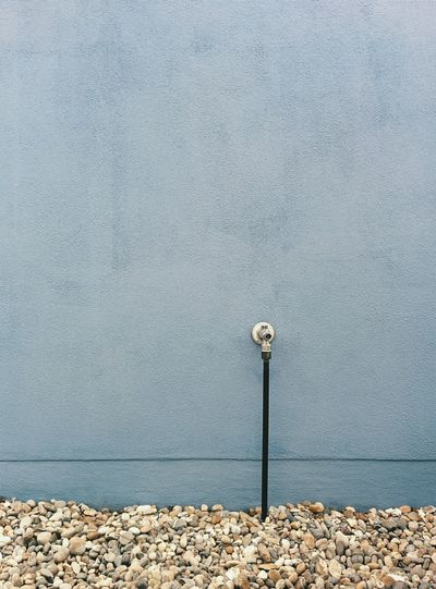 Blue wall and fire hydrant