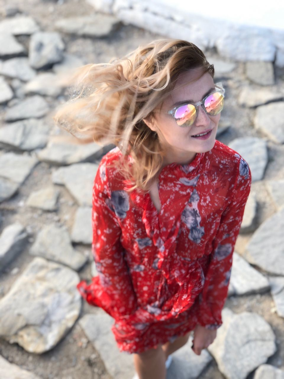 High Angle View Of Woman Wearing Sunglasses While Standing On Footpath
