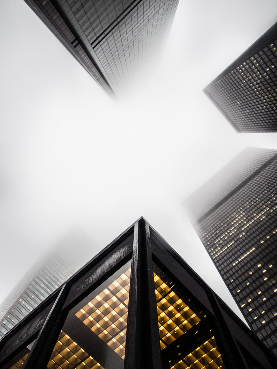 architecture, built structure, building exterior, low angle view, building, sky, office building exterior, skyscraper, no people, tall - high, city, modern, office, fog, nature, day, railing, travel destinations, tower, outdoors, directly below, financial district
