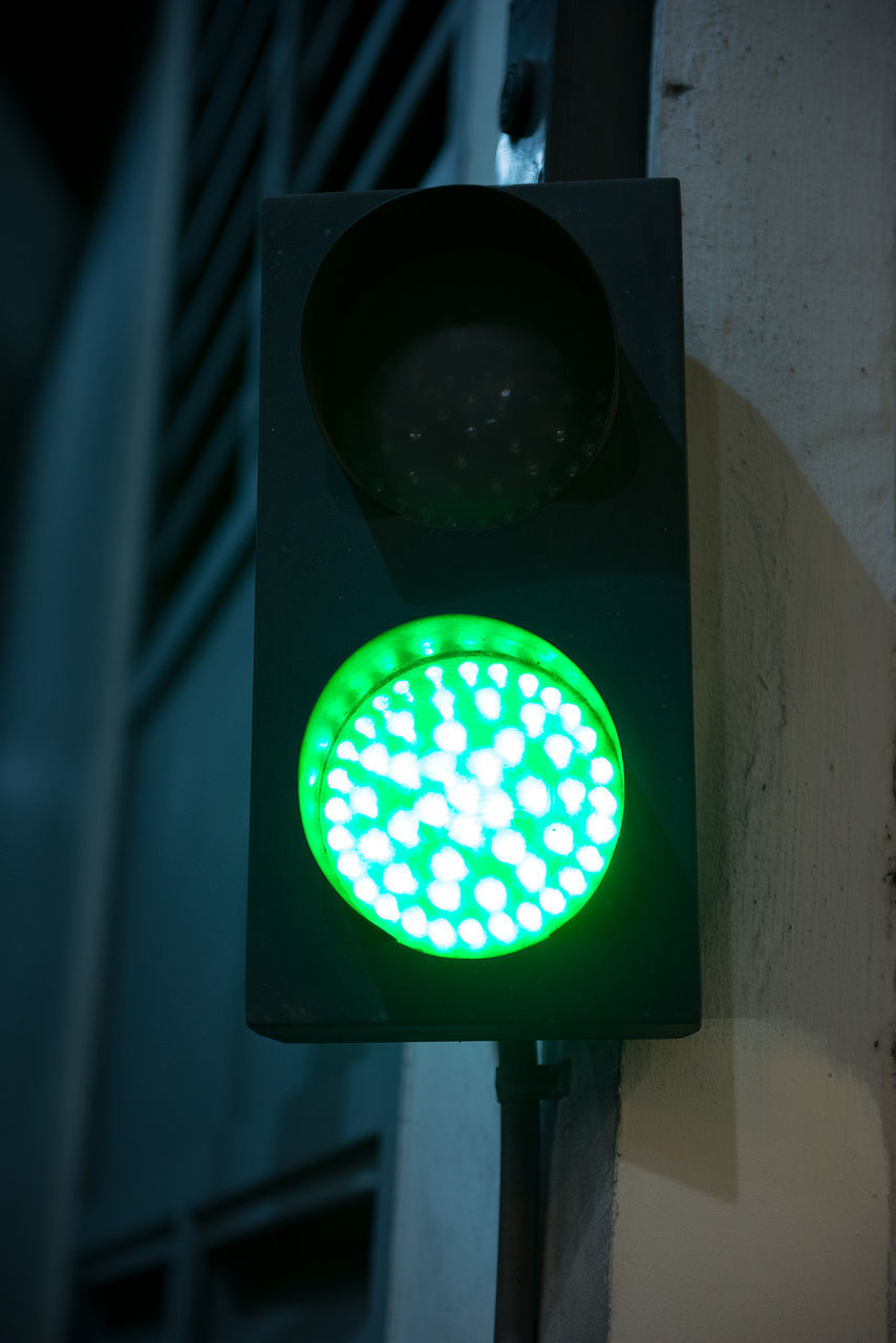 illuminated, safety, green color, stoplight, road sign, guidance, lighting equipment, no people, day, close-up, outdoors, low angle view, architecture