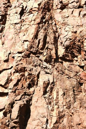 porphyry rock wall in stone pit Natural Background Porphyry Surface Mine Background Natural Backgroud Mining Pit Mining Industry Rock Rock Formation
