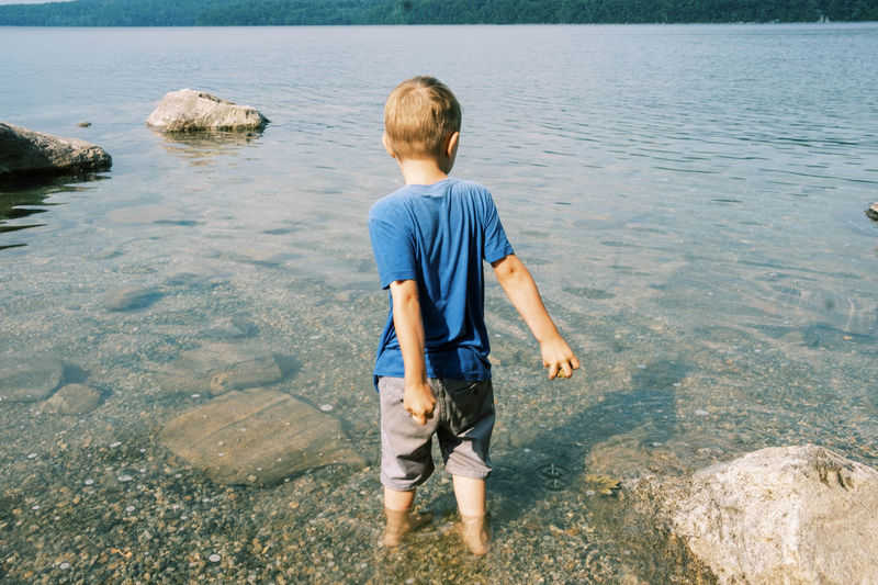 Rear view of boy looking at sea