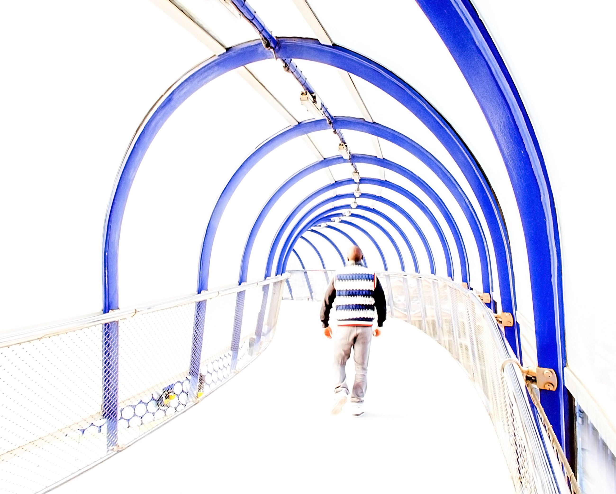 arch, built structure, architecture, railing, the way forward, connection, transportation, walking, lifestyles, men, bridge - man made structure, diminishing perspective, steps, rear view, blue, leisure activity, staircase, steps and staircases